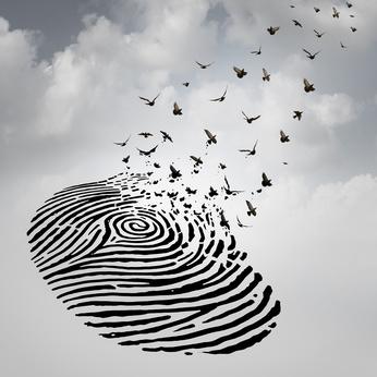 Fingerprint (Identity) in the sky breaking apart into doves flying toward heaven (Christ)