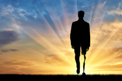 Man walking into rays of sunshine with a prosthetic leg
