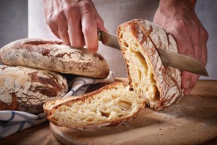 Cutting a loaf of bread